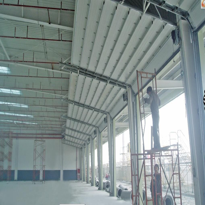 Manual lifting sectional overhead garage door