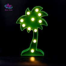 Plastic coconut trees decorate small toilet night light