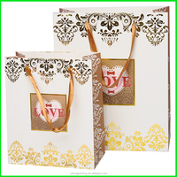 Yiwu Yilong High End Ivory Foldable Printed Retail Paper Bag