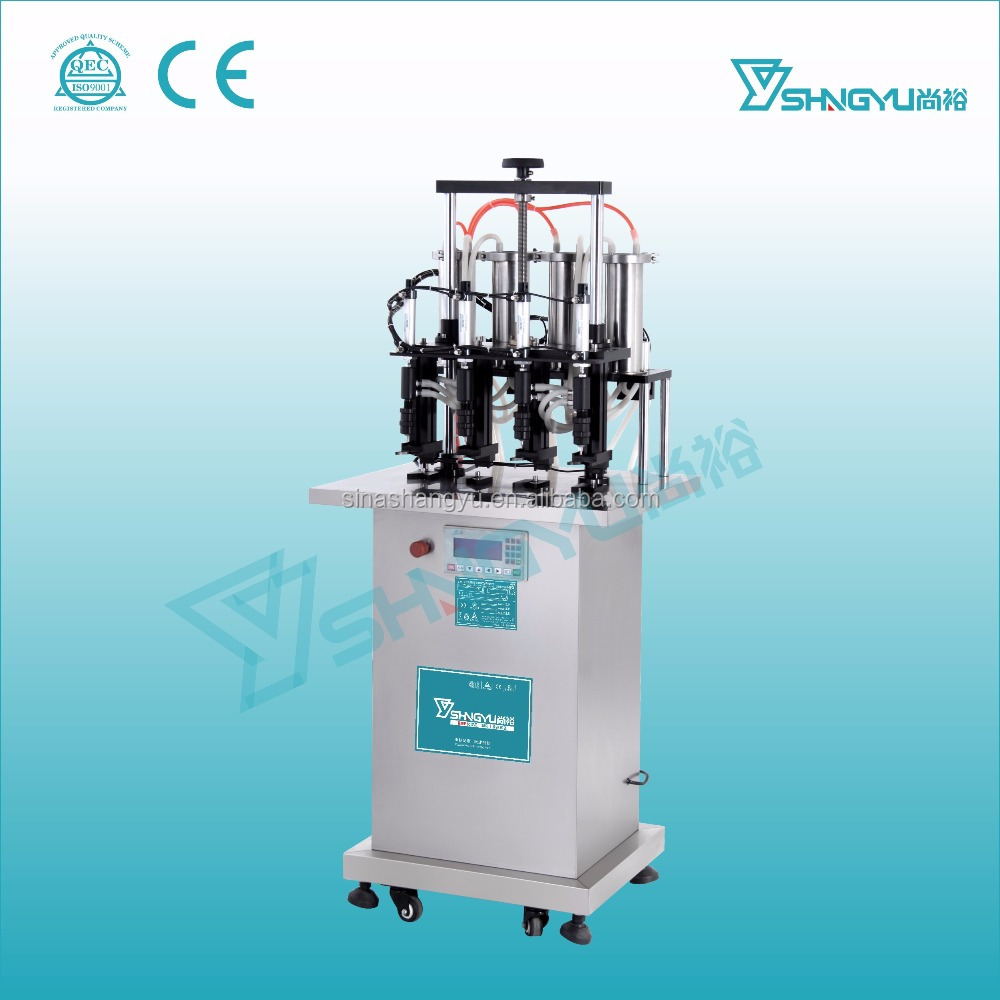 Factory sale semi automatic small 4 heads vaccum perfume glass bottle filling machine
