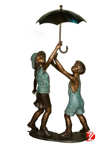 bronze boy and girl statues holding umbrella