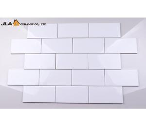 white ceramic herringbone kitchen wall tile mixed colors beveled glossy