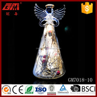 Elegant blown glass angel with red fruit inside for gift