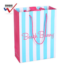 Young girl style vertical bar design ribbon tied beach gift paper bags