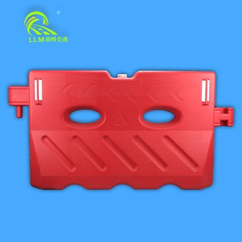 Red and white plastic water barrier