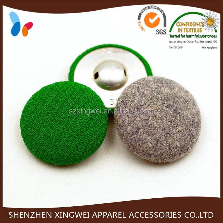 green fabric covered sewing fasteners