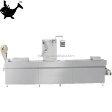 Automatic continuous stretch film vacuum packing machine for food industry