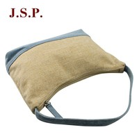 Handbag/shoulder bag with splicing element