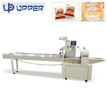 Automatic horizontal flow snacks packing machine