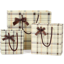 Cream color brand custom made Paper gift Bags with bow tie ribbon