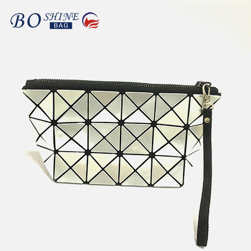 Alibaba wholesale pu travel cosmetic bag geometry make up bag with hand