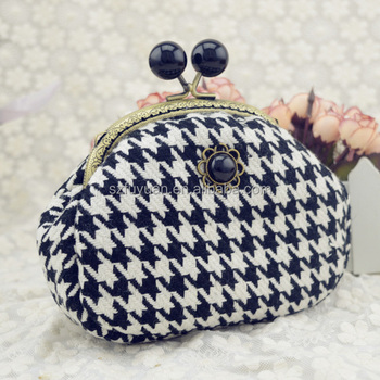 Houndstooth fabric hinge closure clutch bag