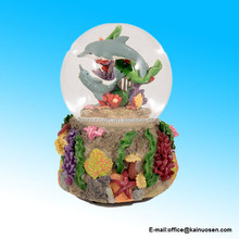 polyresin Dolphins Playing in the Reef Glass Musical Snow Globe