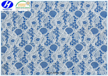 Hongtai 2017 new designer fabrics embroidered lace fabric for clothing fabric
