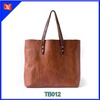Vintage tote bag vegetable tanned leather and included an interior pocket, copper rivets, and a solid bottom.