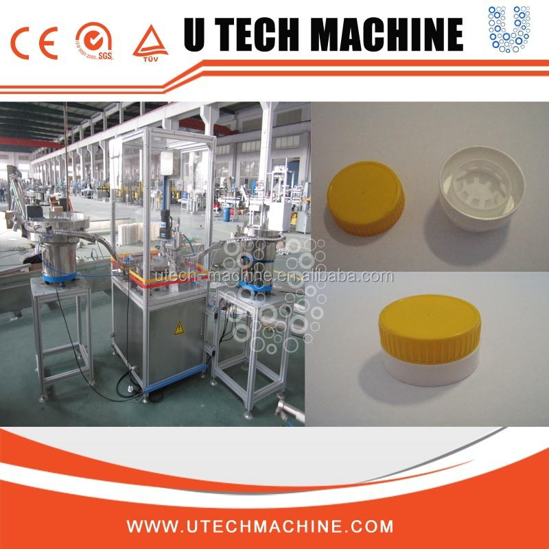 Automatic plastic cap assembly machine