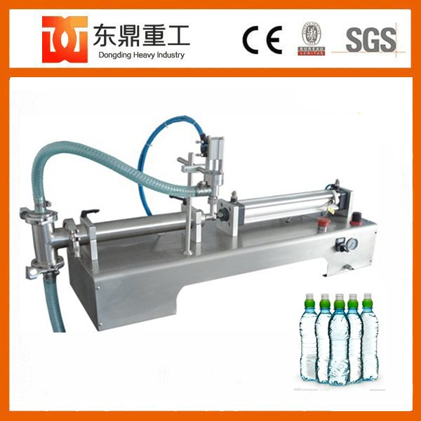 Semi automatic 500 ml filling machine for oil, water and milk