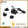 12v 1A 1000mA interchangeable wall socket type power adapter 5.5mm round connector compliance with the COC 5 and DOE VI level