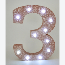 Large wooden numbers with LED lights
