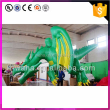 giant hanging inflatable green dragon
