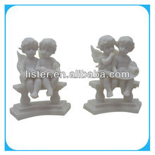 Set of two resin sitting angel figurines