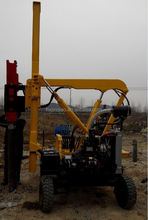 Hydraulic hammering pile driver guardrail machine post driver over truck