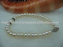 6 MM AA- WHITE BUTTON PEARL BRACELET