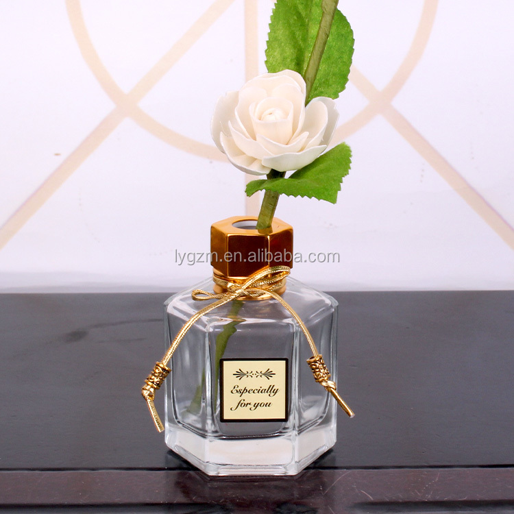 Hexagon shape clear empty aroma reed diffuser custom glass bottle with black gold metal cap
