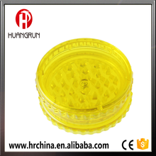 yellow plastic herb grinder
