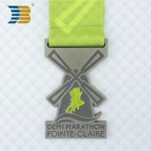 bronze Pointe Claire half marathon medal with ribbon