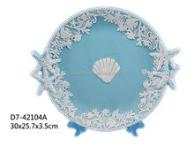 Decorative ceramic cake plate with shell
