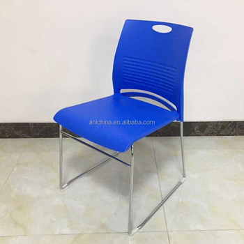 green or white plastic stackable chair