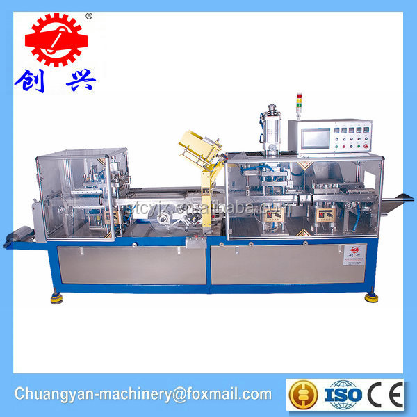 Automatic toothbrush making machine with packing machinery