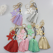 wholesale chinese handmade faux leather metal personalized key chains with tassles