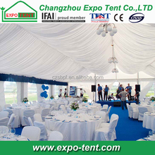 large outdoor wedding tent with white lining