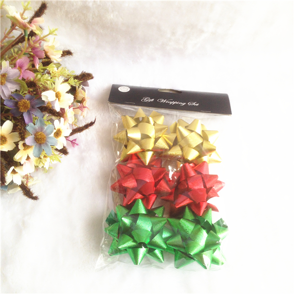 Small pre made plastic ribbon star bows in plastic bags
