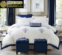 Cheap hotel bed linen sheet imported white luxury embroidered commercial bed linen