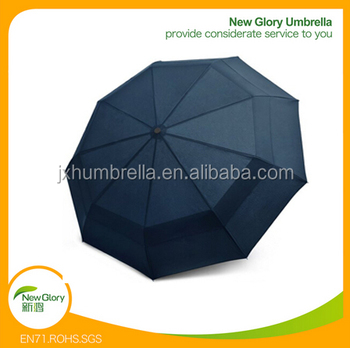 Totes double canopy wind resistant travel fodable umbrella for Wind resistant material