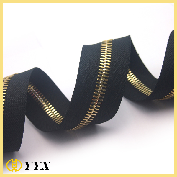 Factory diredctly sells cheap shiny metal zipper gold teeth