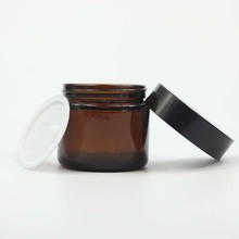 2 oz cosmetic glass container amber 60ml body cream jar with black lid