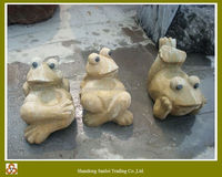 yellow sandstone cartoon frog animal carvings