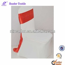 very beautiful white spandex chair cover with red satin sash