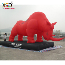 Energy drink brand advertising red inflatable rhino model with long horn