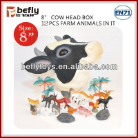 Cow head box with plastic farm animals models