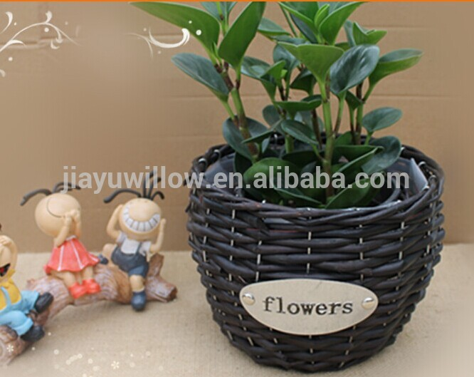 Handmade unique wicker plastic lined plant basket wicker recycled plant pot