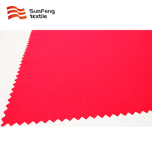 High visibility red fabric for apparel used in traffic industry