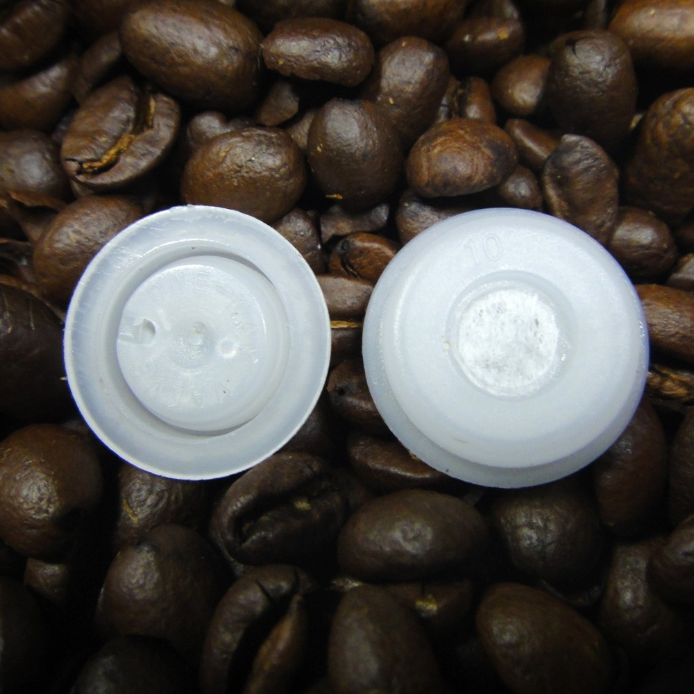 one-way degassing valves for flexible packaging of ground coffee