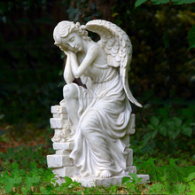 Stone hand carved garden sitting angel with wings sculpture