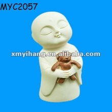Jizo in gassho with Teddy bear figurine