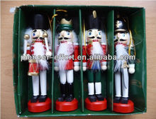 Christmas decorative wooden nutcracker ornaments hanging on Christmas tree